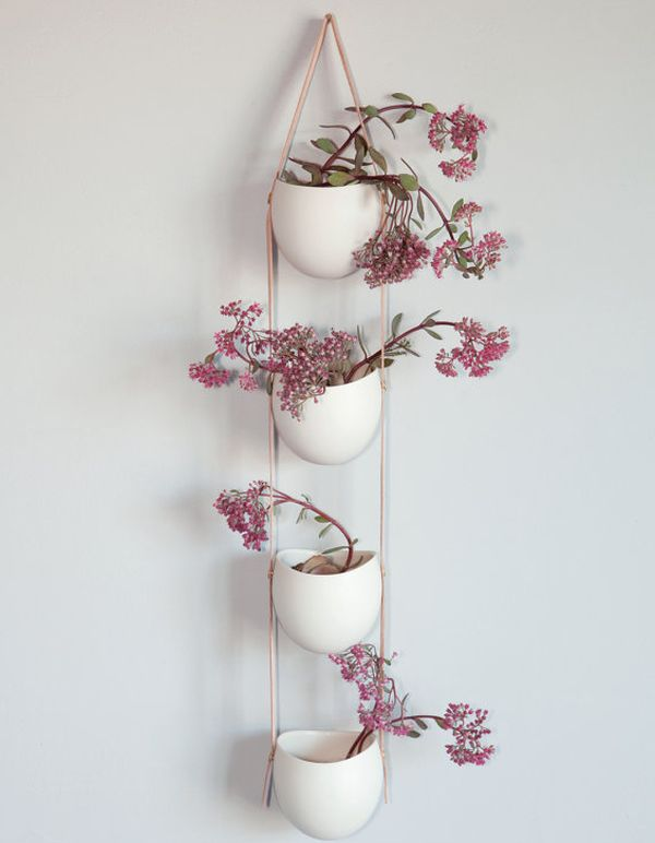Beautiful tiered white and leather plant holders