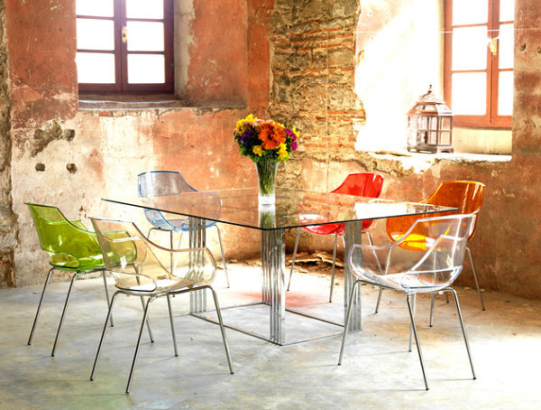Bright plastic chairs in a converted warehouse