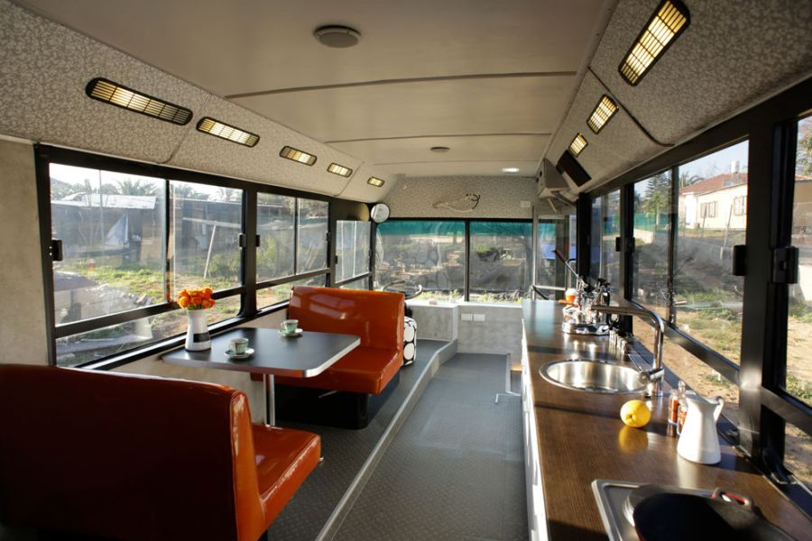 Bright seating options liven up the dining area Beautiful Modern Home In Sharon, Israel Crafted From A Discarded Old Bus
