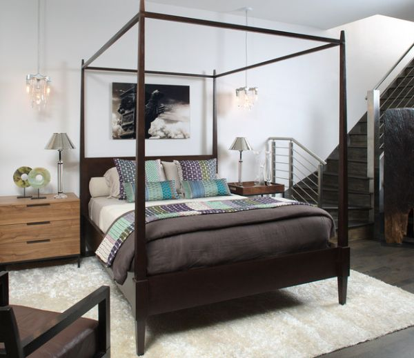 Carpet and four poster demarcate a bedroom in an open floor plan Four Poster Bed: Usher In The Holiday Retreat Vibe!