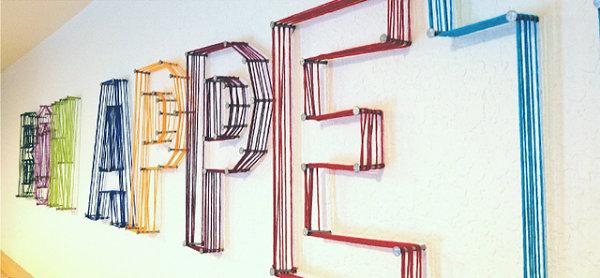 Colorful letter yarn art