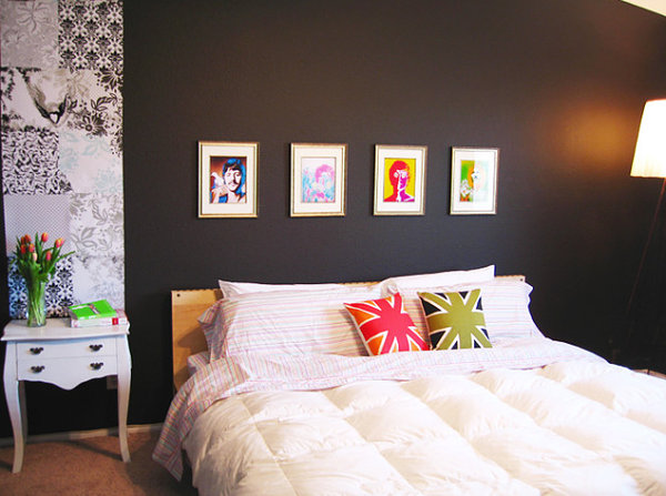 Colorful pillows and artwork in a dark bedroom
