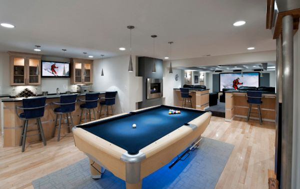 Cone pendants enhance the dreamy blue shades of the pool table