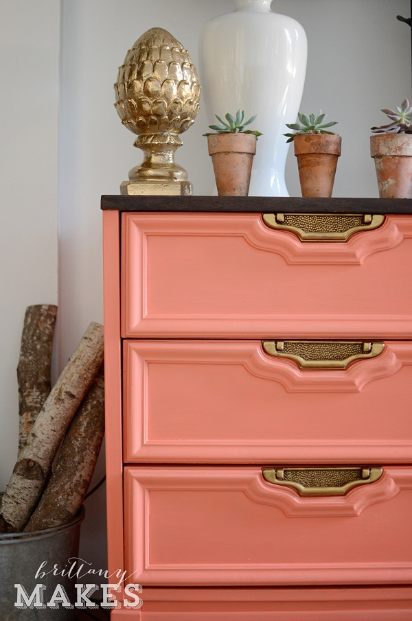 Coral and gold dresser