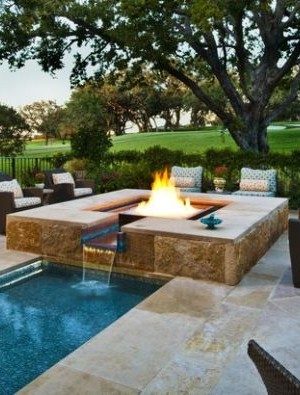 Custom designed glass fire and water feature for the pool