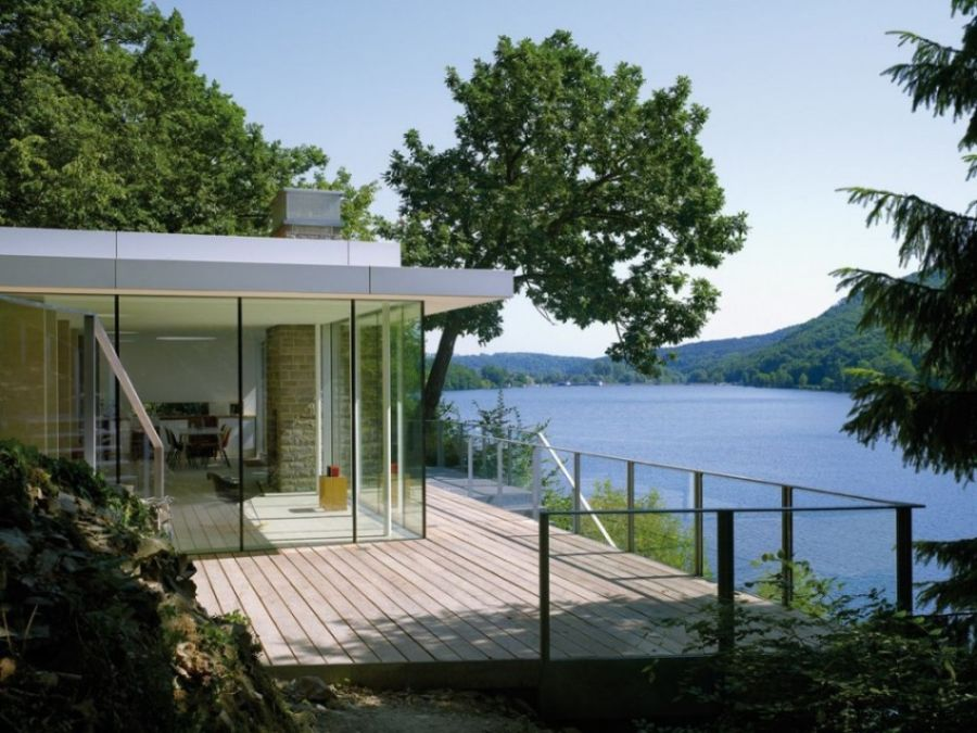 Modern german house clad in glass offers unabated lake views for Lake house plans with a view