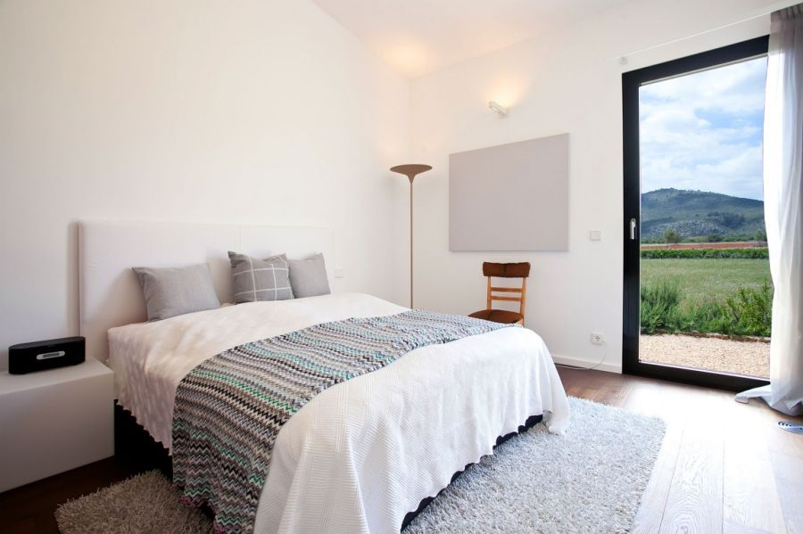 Exquisite bedroom in white at the holiday home in Mallorca by ecoDESIGNfinca