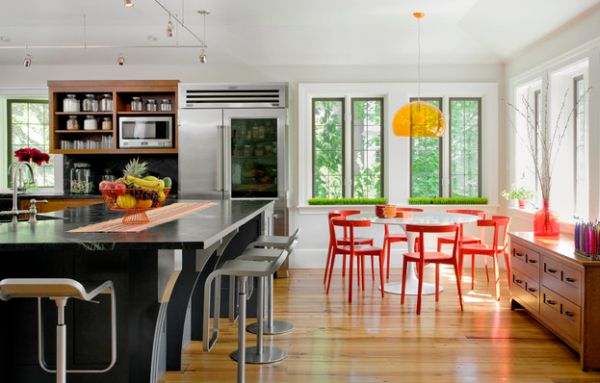 FL/Y pendant and colorful seating surround the Tulip table