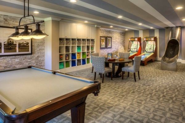 Fun game room with arcade games and an awesome slide entrance!
