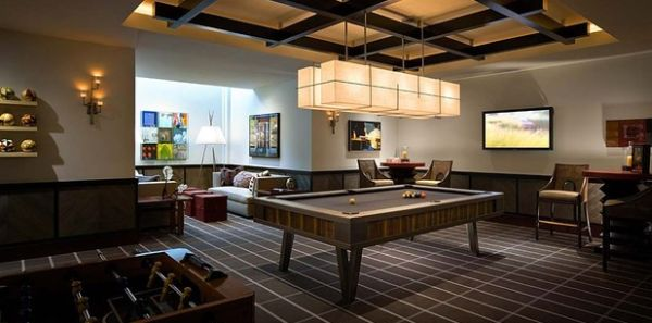 Game room with bronze and anodized steel billiards table