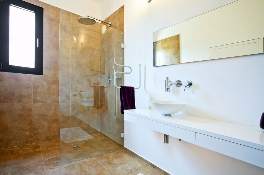 Glass shower area in the modern bathroom