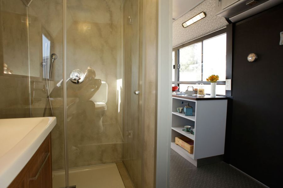 Glass shower enclosure in the bus