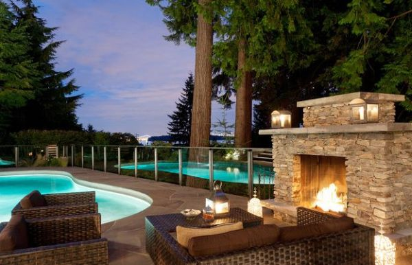 Gorgeous stone fireplace next to the pool