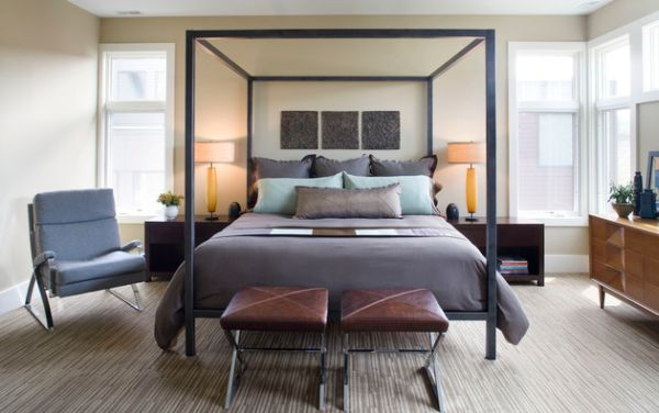 Gray bedroom with four poster bed exudes a distinctly masculine style!
