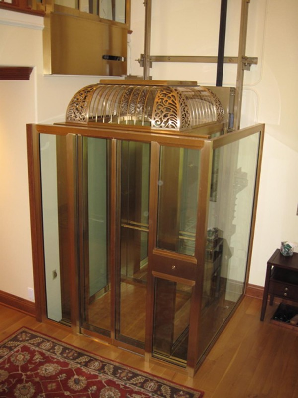 Rich wood, brass and glass home elevator