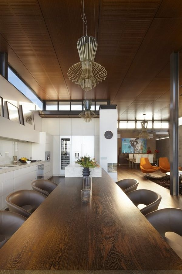 Interesting lighting fixtures above the dining table