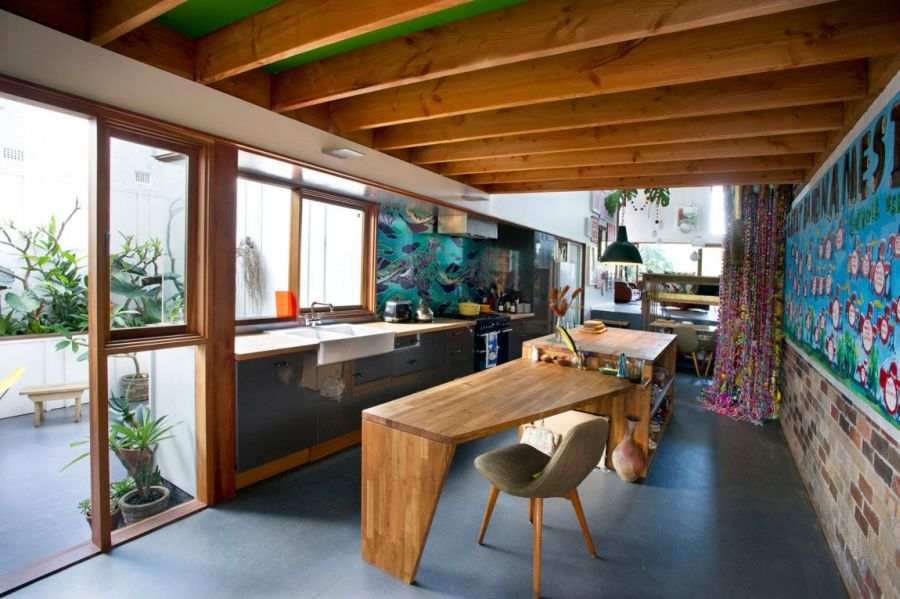 Kitchen dominated by wooden tones