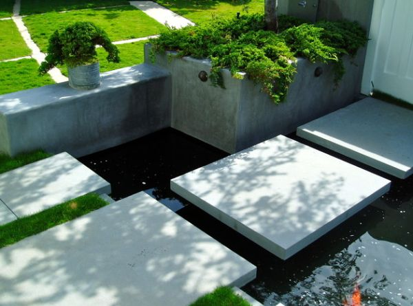 Koi pond in front yard with stylish floating steppers for Contemporary pond design