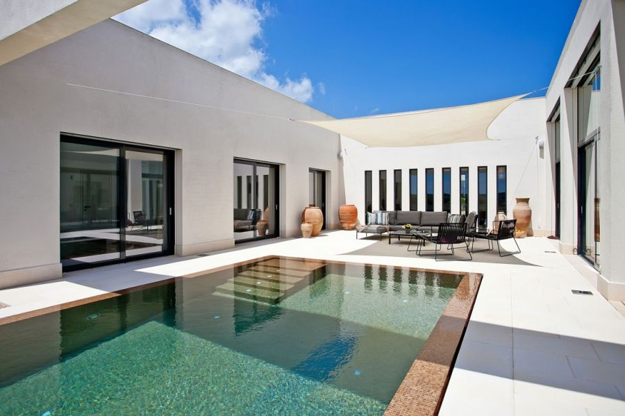 Luxurious holiday villa in mallorca charms with its breezy for Kapfer pool design mallorca