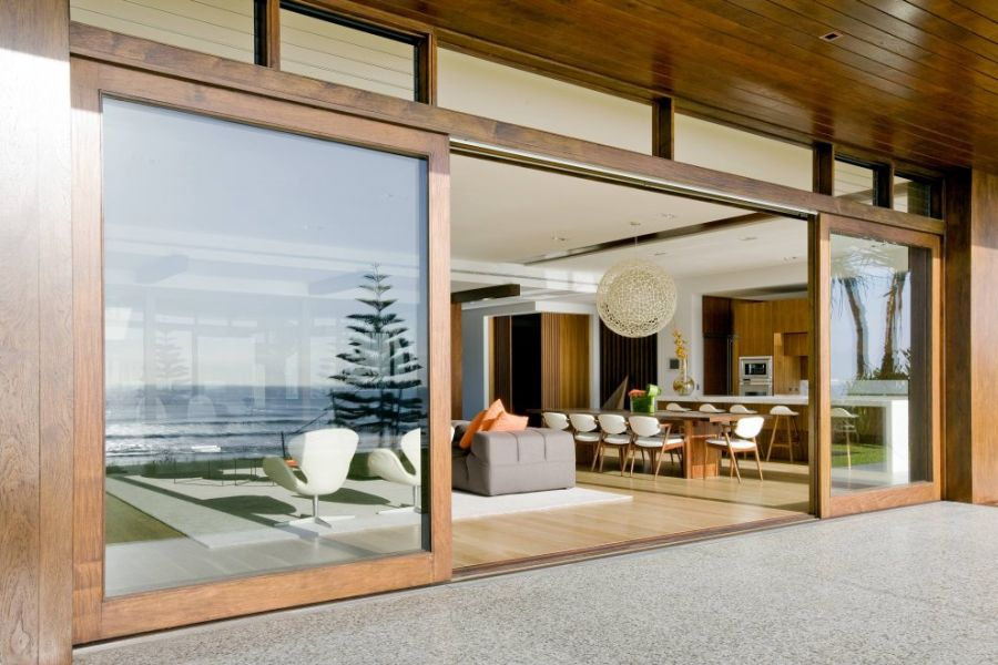 Large sliding glass doors with wooden frame