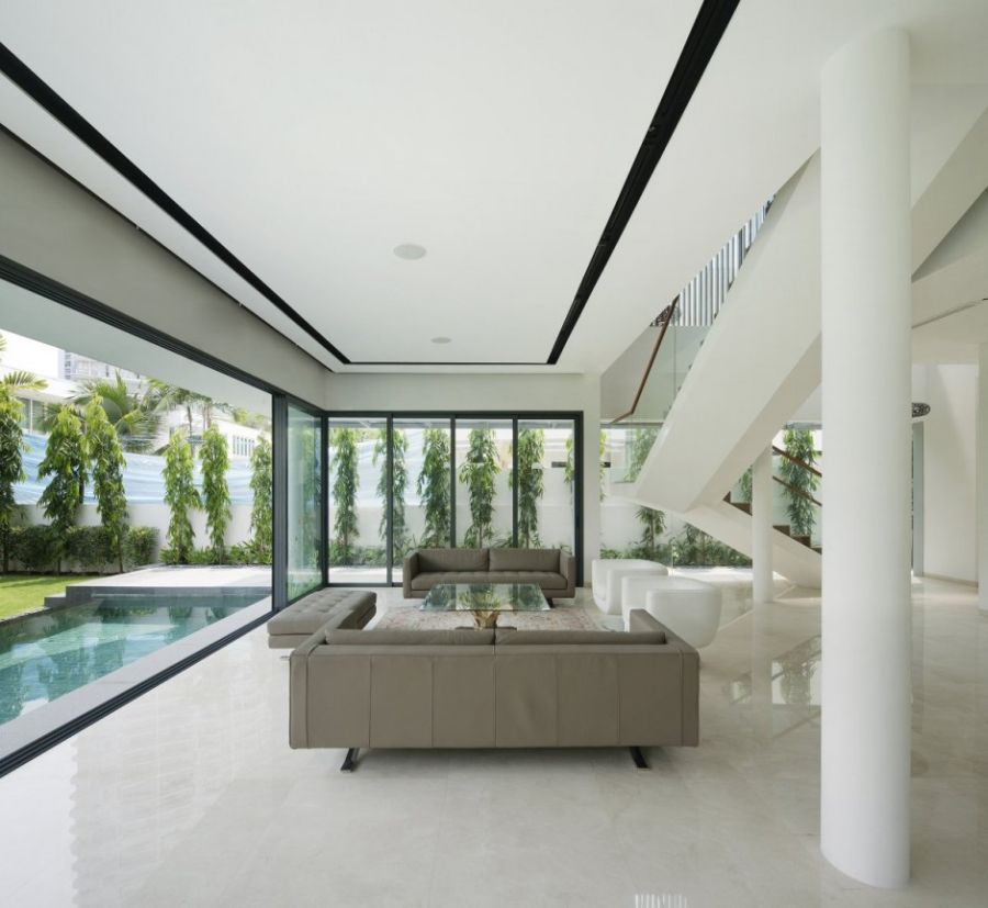 Living room along with the swimming pool Wind Vault House: Exceptional Façade Meets Exclusive Interiors