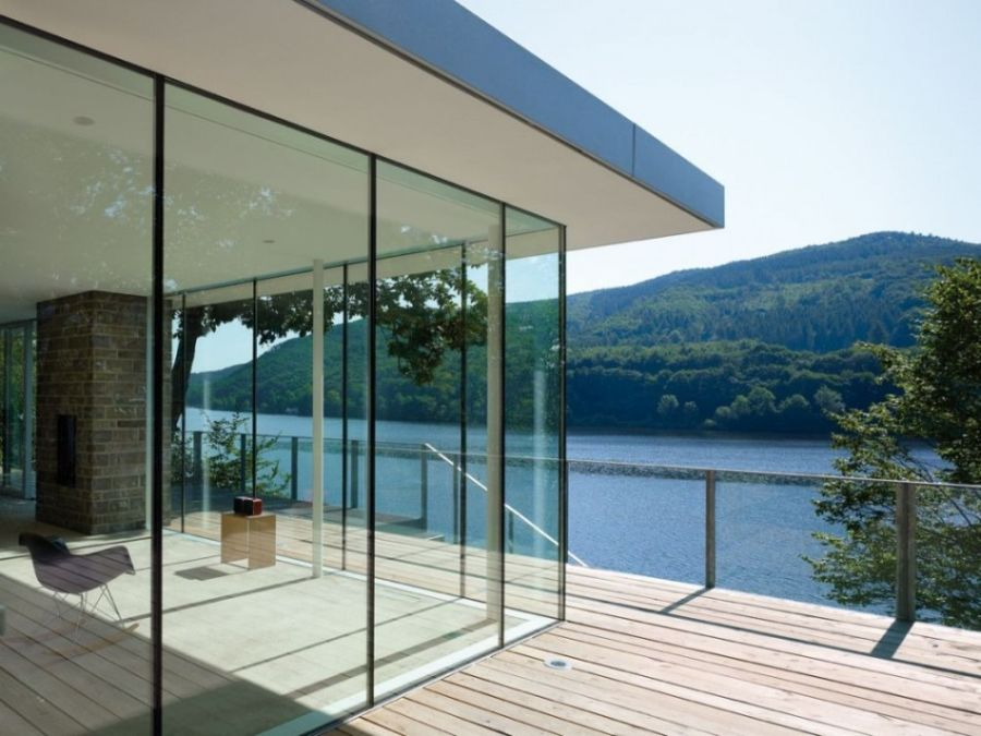 Lovely glass walls of lake house offer unabated views