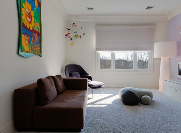 Lovely kids' room with Saarinen's Womb Chair and smartly placed felted wool stones