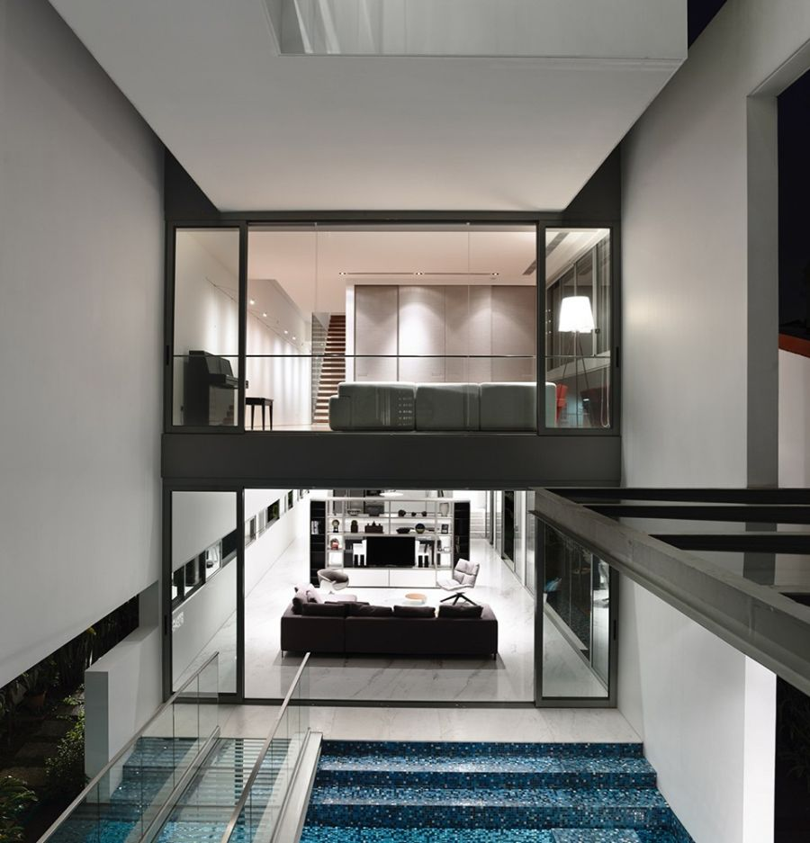 Luxurious indoors with a refreshing pool Inside of a Stylish Home in Singapore