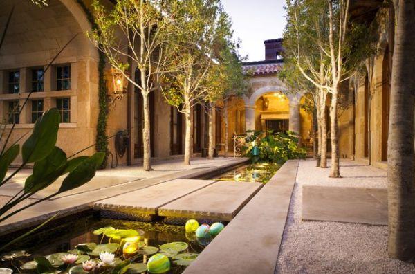 Mediterranean styled koi pond garden looks stunning