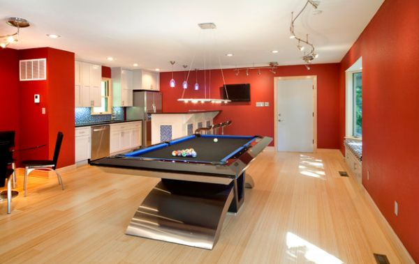 Metallic tinges give this game room a futuristic appeal