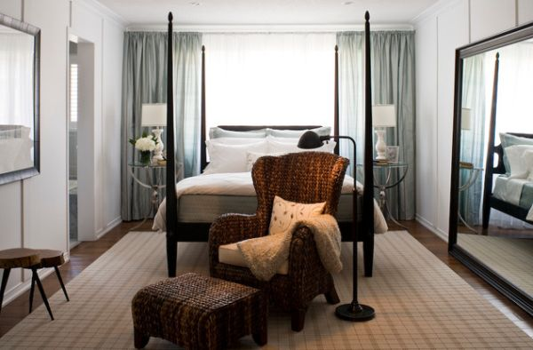 Mirror creates greater visual space in the compact bedroom