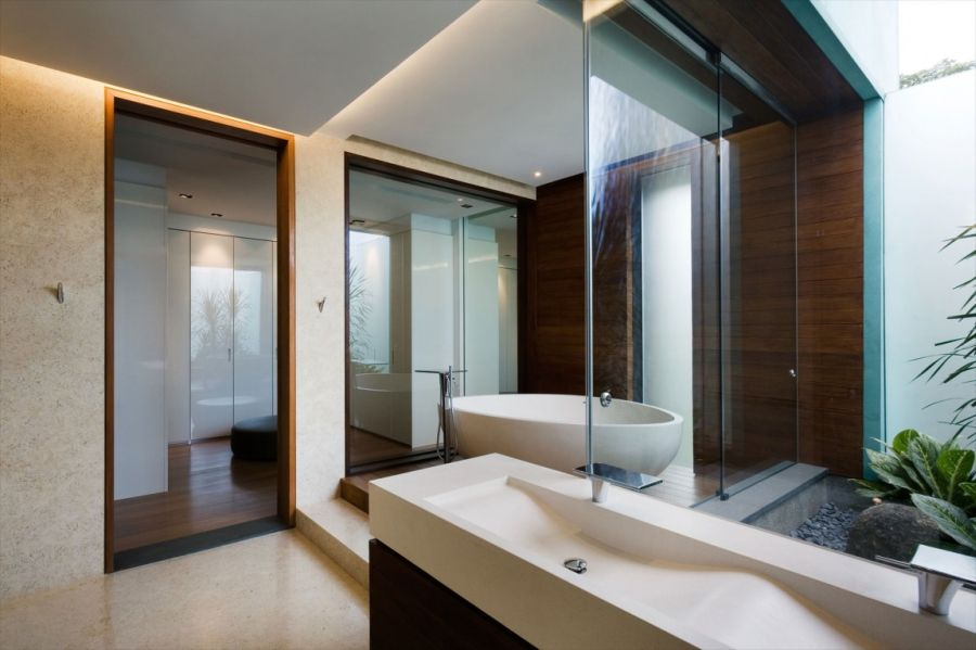 Modern bathroom in stone and glass