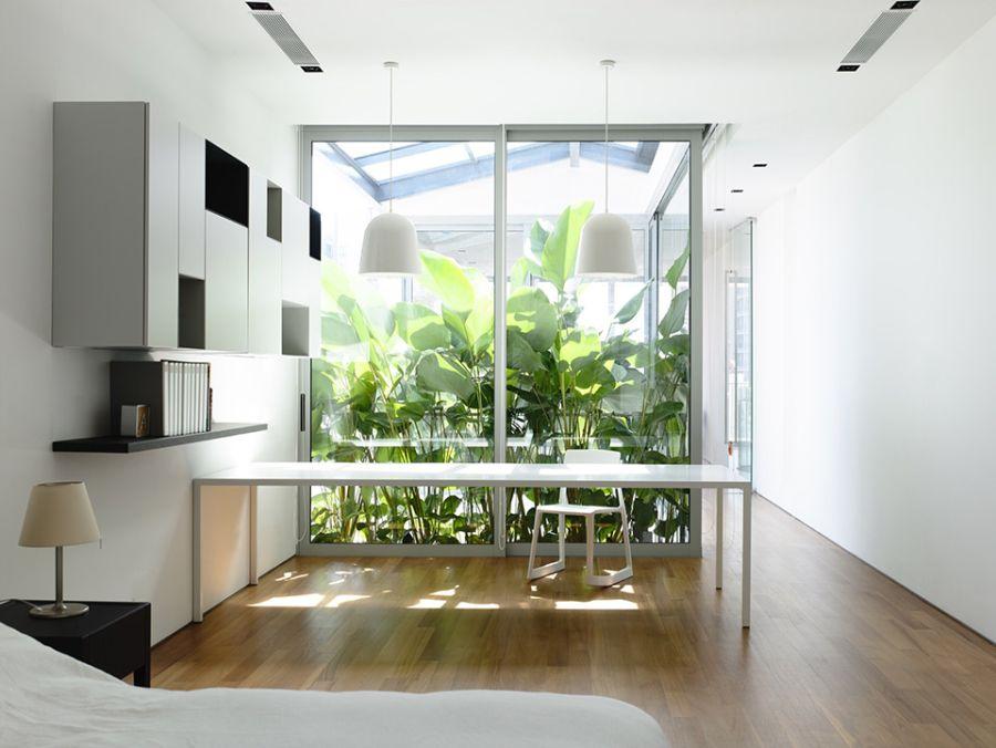 Modern bedroom with glass windows