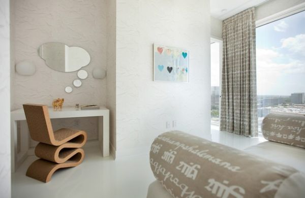 Modern bedroom with mirror shaped to mimic a dialogue bubble