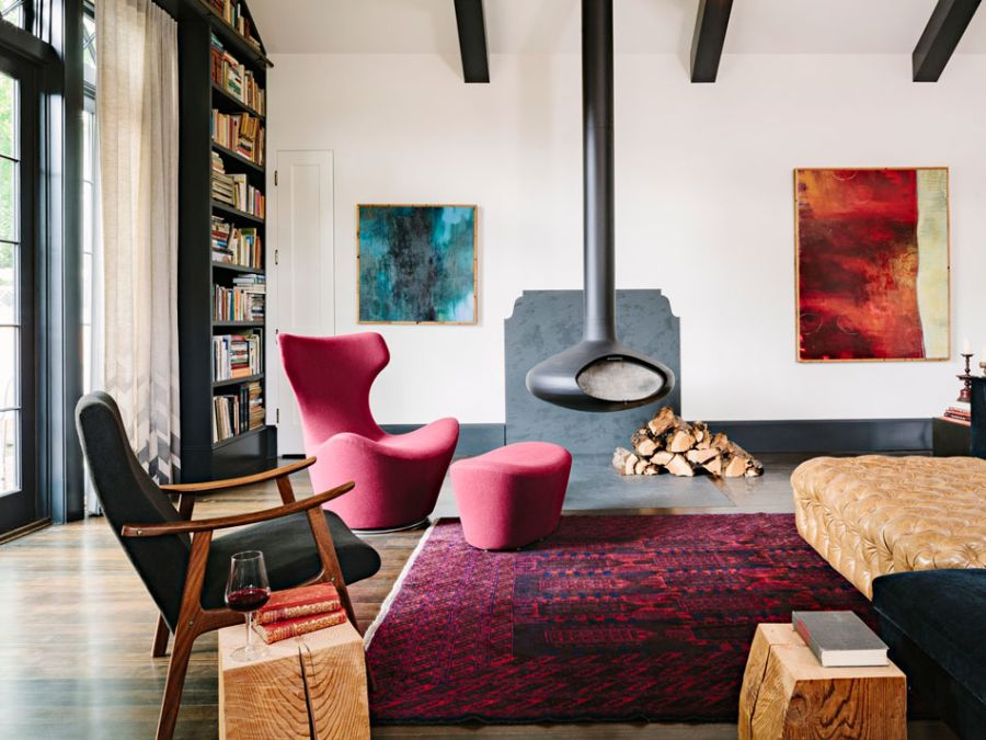 Modern fireplace keeps the library house warm