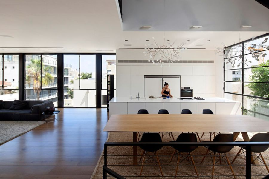 Modern kitchen and dining area in the Tel Aviv Home