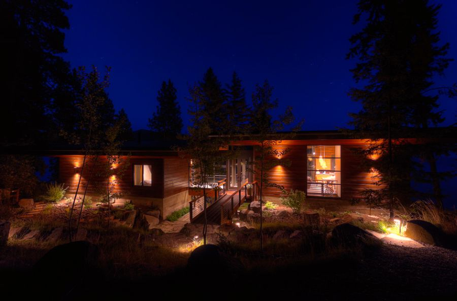 Natural green surrounding the cabin Elegant Coeur D'Alene Cabin Blends Lovely Lake Views With Modern Interiors