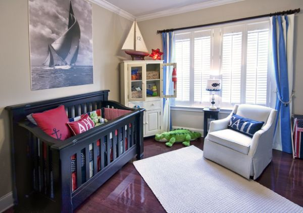 Nautical theme accentuated with sailboat motif in kids' bedroom