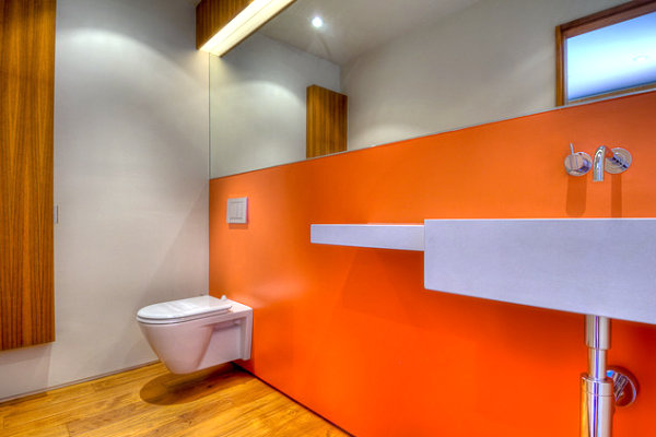 Neon orange bathroom wall