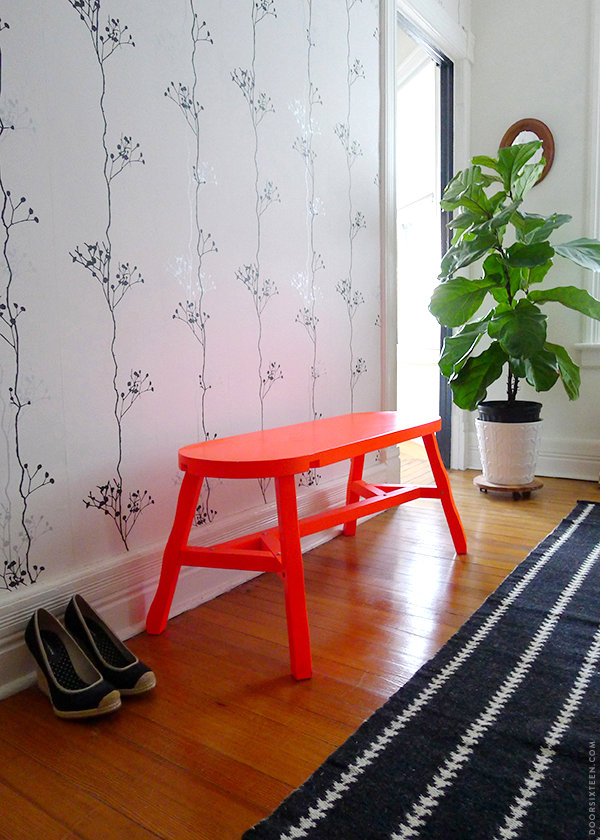 Neon orange bench in a modern hallway