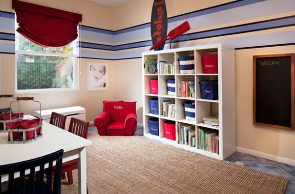 Organized kids' playroom with surfboard decor addition to the wall