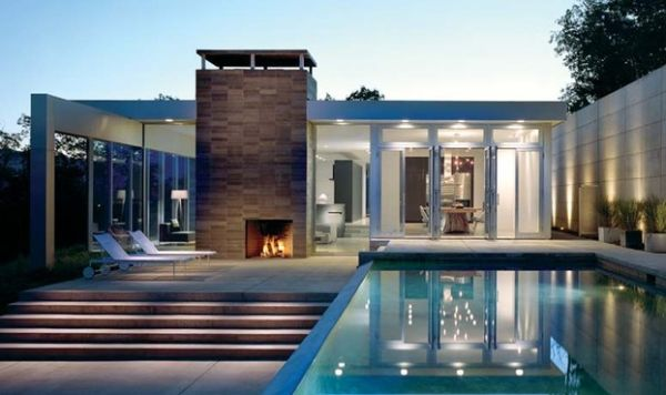 Outdoor fireplace next to the pool completes your patio or deck space