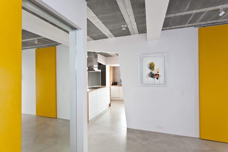 Pristine white walls and yellow accents