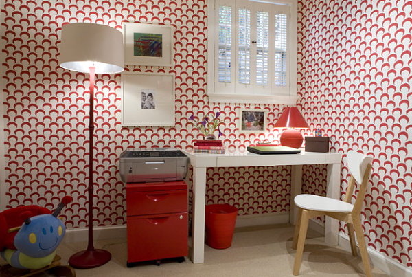 Red floor lamp in a wallpapered space
