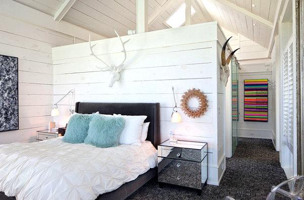 Rustic bedroom with neon artwork