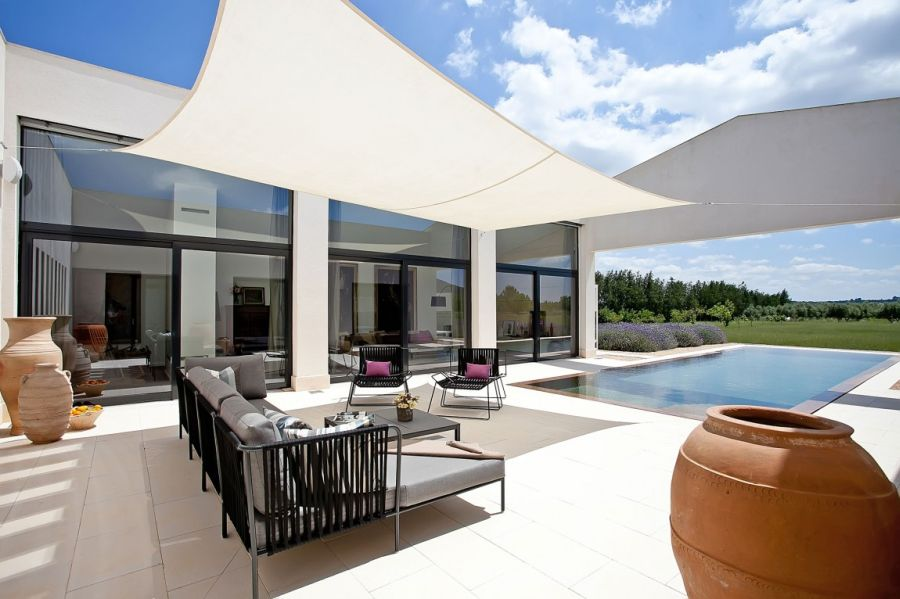 Shaded patio looks as an open and airy look