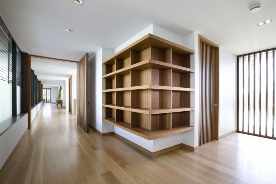 Sleek wooden shelves at the Albatross Project home