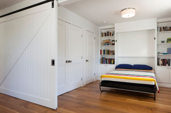 Sliding door and Murphy bed create a bedroom out of an open niche