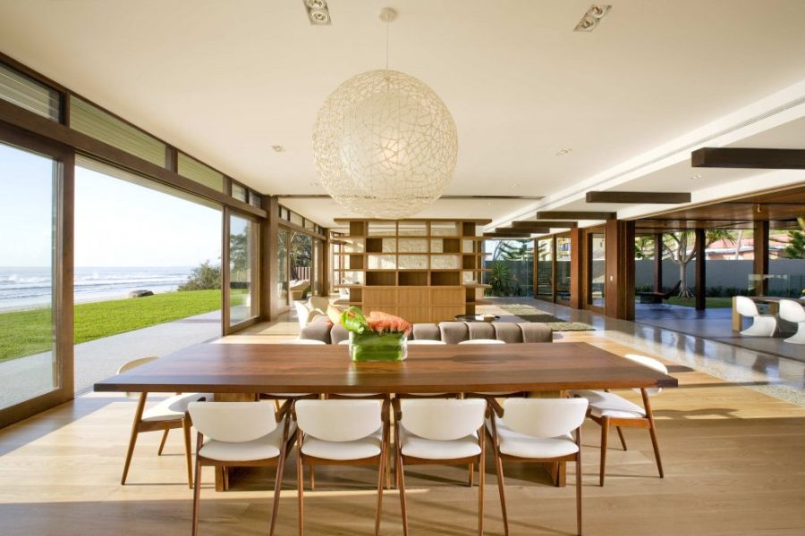 Sliding glass doors connect the outdoors