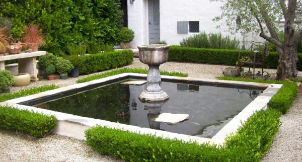 Square koi pond with lovely boxwood border